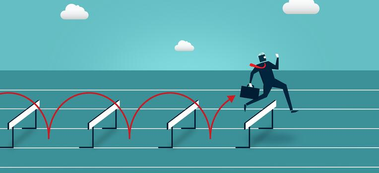businessman jumping over barriers