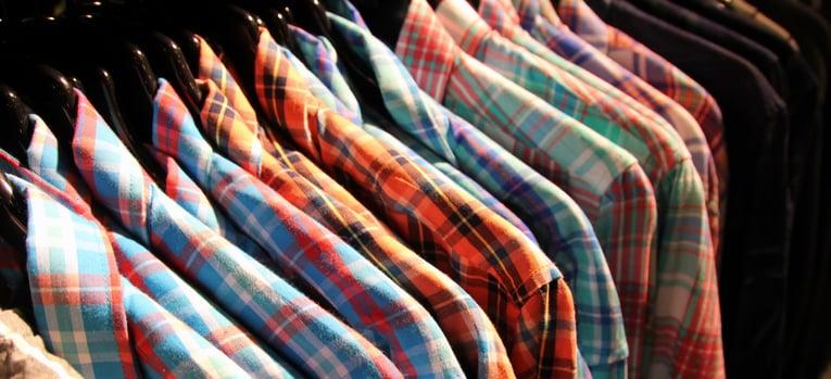 plaid shirts hung on a rack