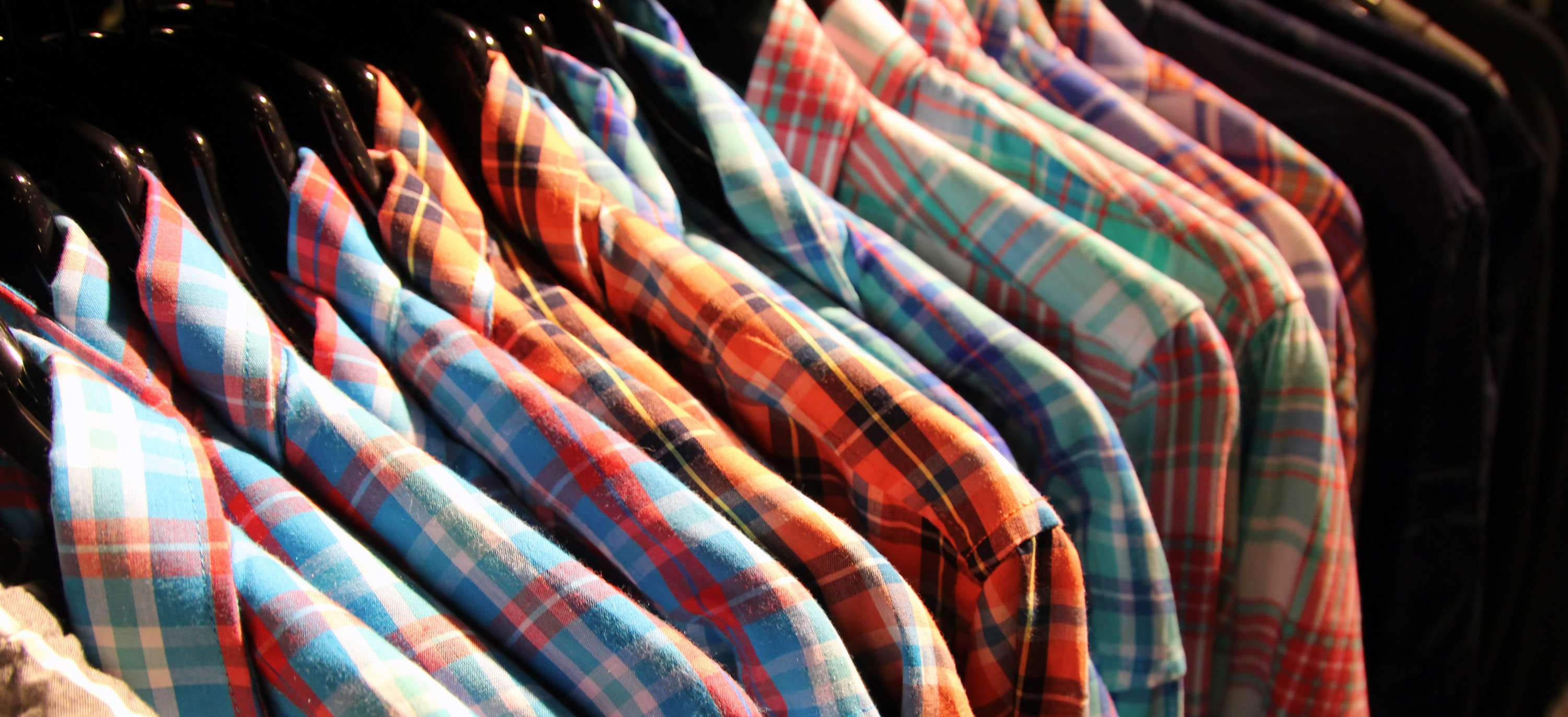 plaid shirts hung on a rack