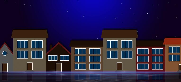 row of houses in the moonlight